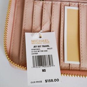 Michael Kors Bags - Michael Kors Jet Set LG Phone Wristlet Pink Ballet